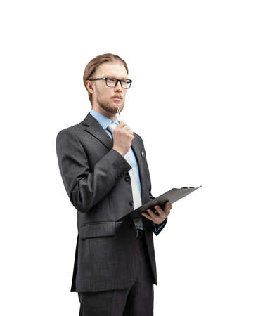 vertical portrait one man businessman or office-worker in glasses spectacles, stand with notebook and thinking, on white background, isolated