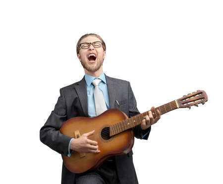portrait one man businessman or office-worker playing on musical instrument - guitar and loud sing, on white background, isolated