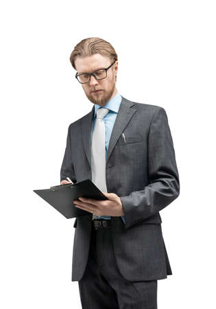 vertical portrait one man businessman or office-worker in glasses spectacles, stand with notebook and writes, on white background, isolated