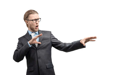 portrait one man businessman in glasses spectacles, showing magic gesture, on white background, isolated
