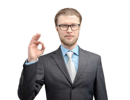 portrait one man businessman in glasses spectacles, showing gesture OK and look on camera, on white background, isolated