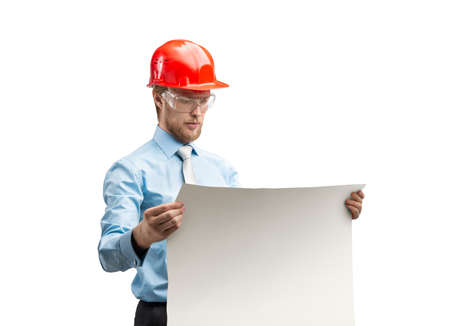 portrait one smart architect worker or engineer man in red construction helmet reading drawing - draft, on white background, isolated Stock Photo