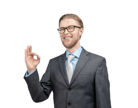 portrait one man businessman in glasses spectacles, showing gesture OK and look on camera and smile, on white background, isolated Stock Photo