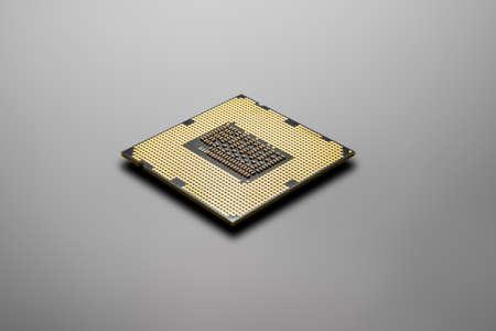 one PC processor on gray background, closeup photo hi-tech concept Stock Photo