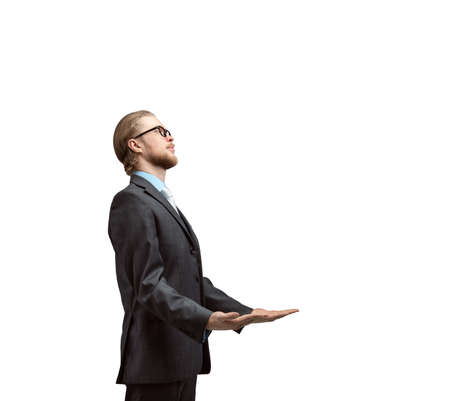 vertical portrait one man businessman or office-worker stand side view and holds in his hands, on white background, isolated Stock Photo