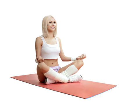 cutie athletic girl, sit inposition lotus, on white background, isolated. Fitness concept