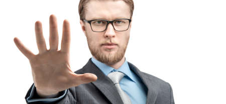 portrait one man businessman in glasses spectacles, showing gesture palm STOP or five fingers and look on camera, on white background, isolated