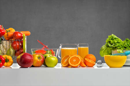 still life cfreshly squeezed juice, fruit and vegetables on table, on gray background Stock Photo