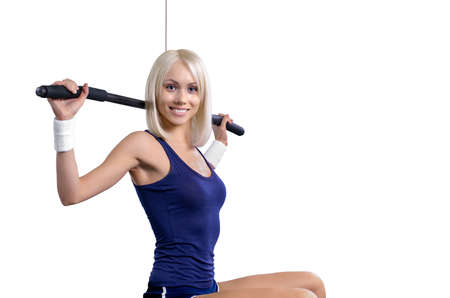 beautiful fitness woman perform exercise with exercise-machine on white background, isolated Stock Photo