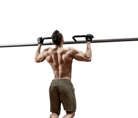 man - bodybuilder perform exercise chin-up on horizontal bar on white background, isolated
