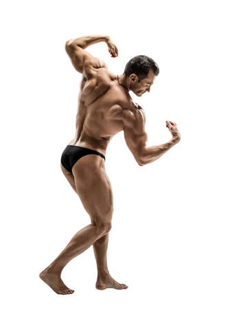 one man - bodybuilder standing on white background, isolated Stock Photo