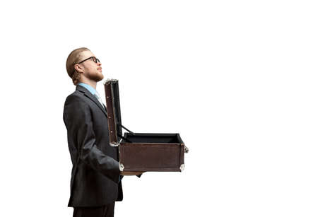 man holds in his arms open suitcase, on white background, isolated. Delivery; shipping concept