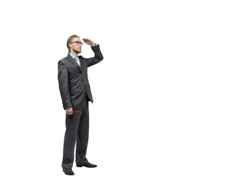 vertical portrait one man businessman or office-worker in glasses spectacles, stand and scours the land beyond (looking gaze), on white background, isolated
