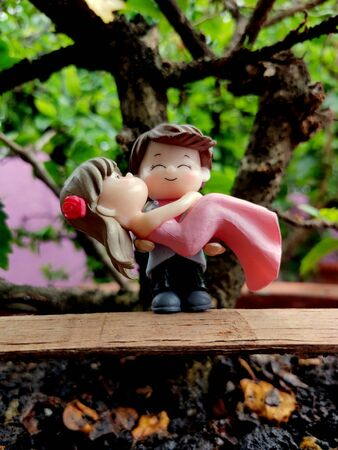 Innovative showpiece image of cute boy and girl on flower pot. Imagens