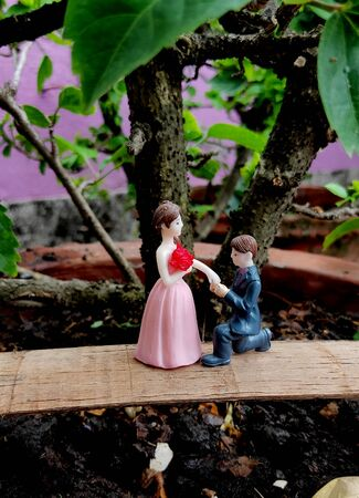 Innovative showpiece image of cute boy and girl on flower pot.