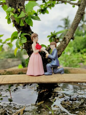 Innovative showpiece image of cute boy and girl on flower pot. Stock fotó