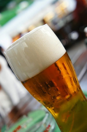 amber coloured: Big glass of beer with a lot of foam