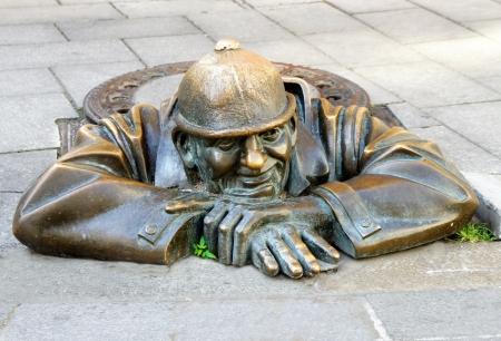 gazer: Bronze sculpture Man at work alias Cumil, Bratislava, Slovakia