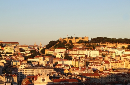Sunset in Lisbon, Portugal –  panorama of buildings, roofs, churches