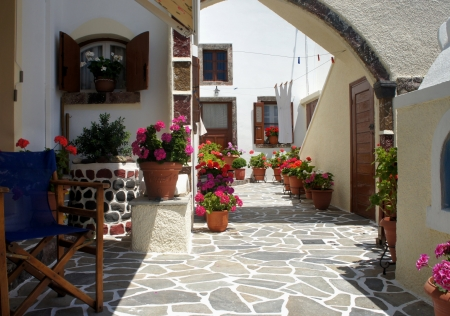 Santorini court with a lot of flowers