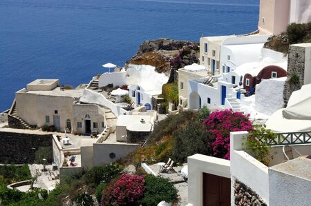 Santorini small white houses and streets photo