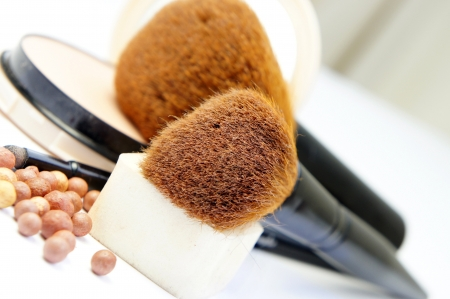 Makeup room: makeup foundation, powder, bronzer and brushes      Stock Photo