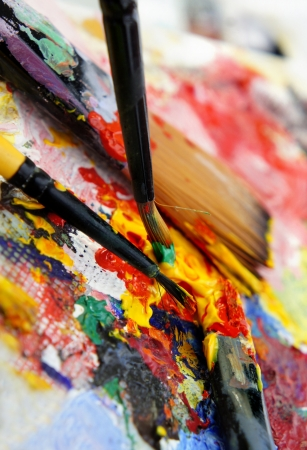 Art palette and brushes with a lot of colors                       Stock Photo