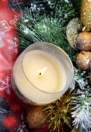 Christmas decoration: pine, nuts, candle Stock Photo - 15684392