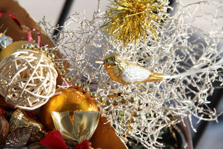 Big mix of Christmas decorations and golden bird on the white branch  photo