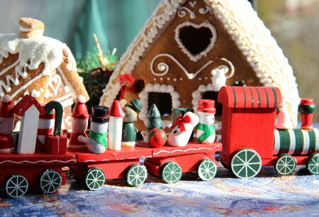 Christmas baked sweet houses and toy train with funny passengers Stock Photo - 15869737