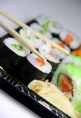 Sushi specialties and chopsticks  photo