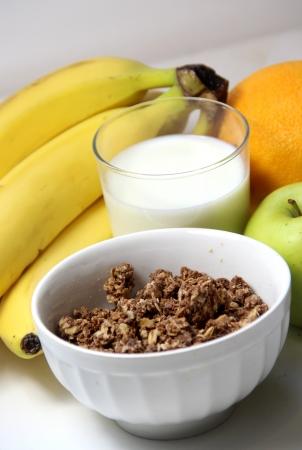 Tasty breakfast: chocolate muesli and fruits  photo