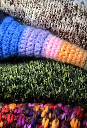 Woolen background  sweaters and scarf photo