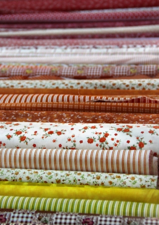 Big assortment of fabrics in the textile store  photo
