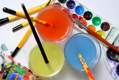 Art palette, watercolors, brushes and water Stock Photo - 16709915