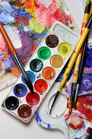 Art palette, watercolors and brushes photo