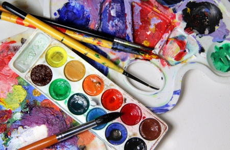 aquarelle painting art: Art palette, watercolors, brushes and water  Stock Photo