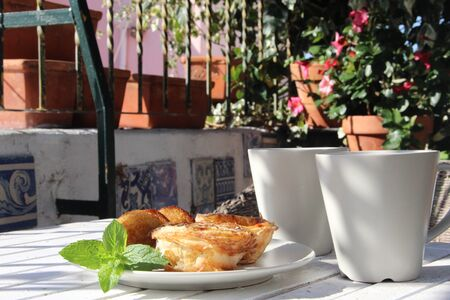 Tasty cakes in Portugal style and tea photo