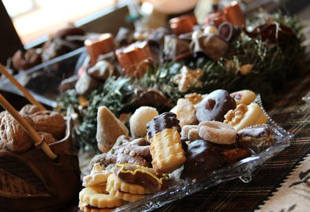 Wreath and mix of homemade sweets on the Christmas table photo