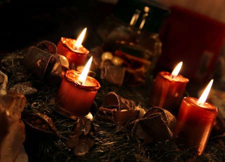 Christmas wreath and burning candles  photo