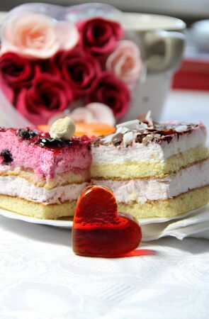 Valentines Day decoration, roses, cake and glass heart  photo