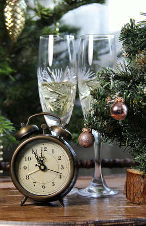 New Year celebration with champagne and old clock