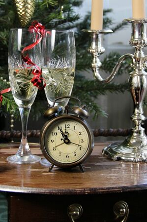 New Year celebration with champagne and old clock   photo
