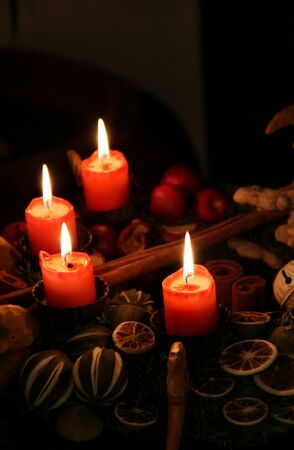 Traditional Christmas wreath and burning candles photo