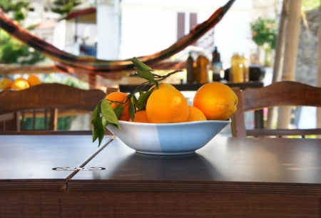 Summer terrace with hammock and oranges on the table  photo