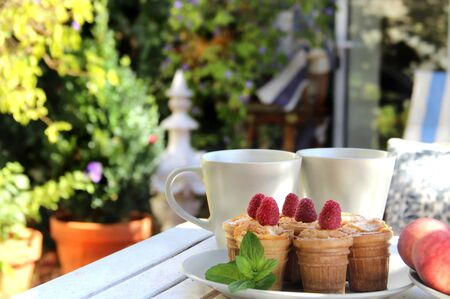 Tasty waffles and beautiful rich decorated summer terrace photo