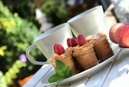 Tasty waffles and beautiful rich decorated summer terrace Stock Photo - 17451931