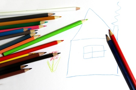 Mortgage in happy style - painted house and multicolored pencils photo