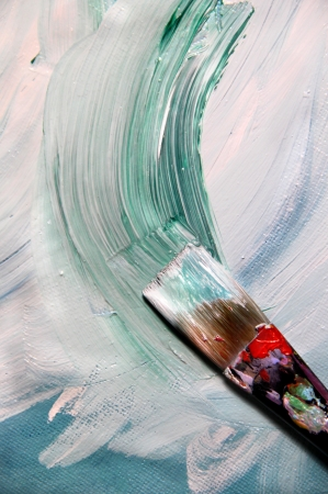 Oil mixing painting on the canvas and paintbrush