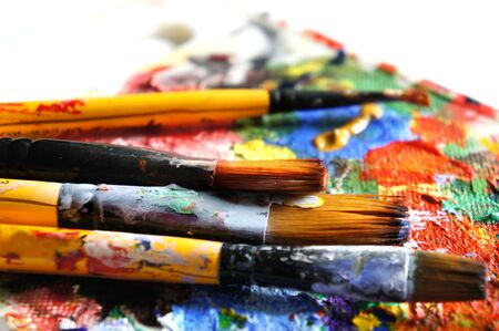 Mix of vivid paints and paintbrushes             Stock Photo - 17573212